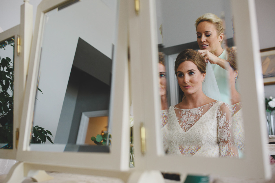 Photo of the bride in the mirror at a wedding in Jersey, Channel Islands