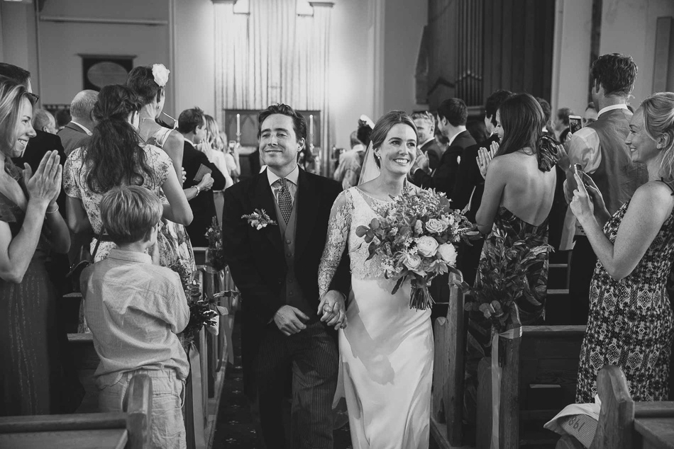 Jersey wedding photography - bride and groom exit the church