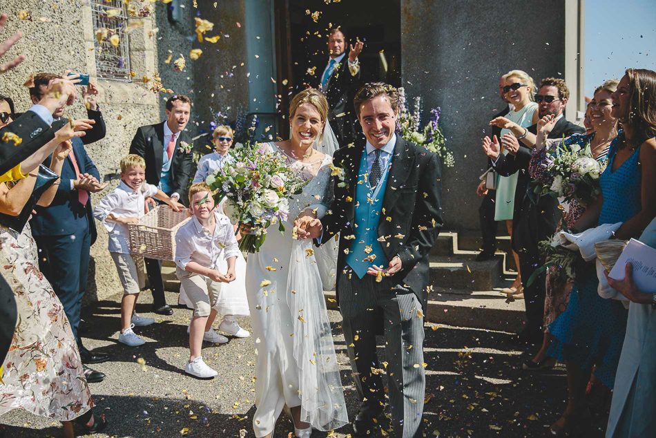 Jersey wedding photography. A confetti throw outside Gouray church.