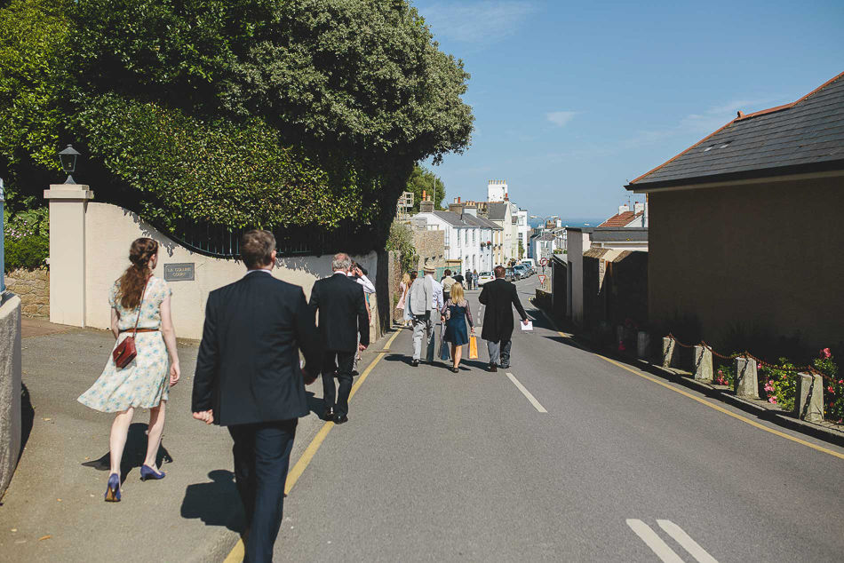 Guests walking to the reception at a wedding in Jersey, Channel Islands