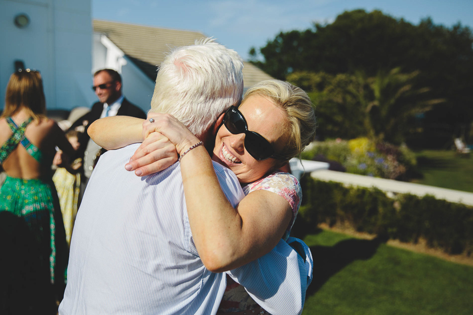Wedding guests hugging at a wedding in Jersey, Channel Islands