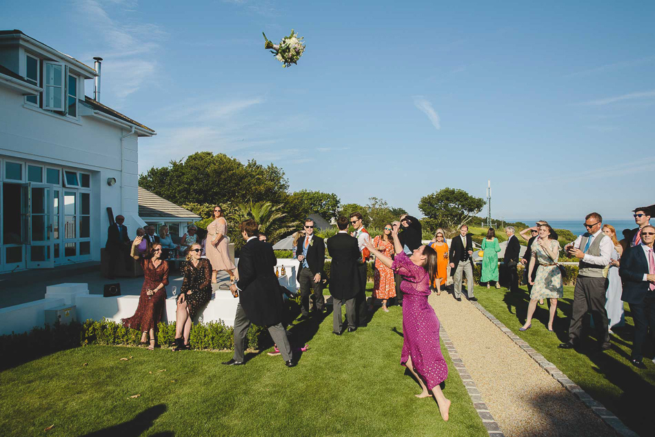 The bouquet toss at a wedding in Jersey, Channel Islands