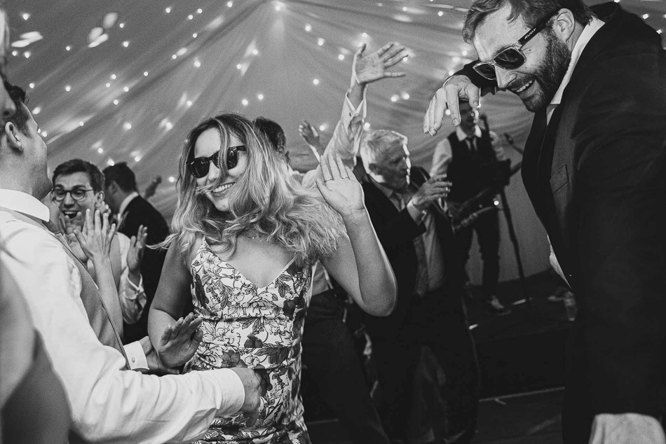 Jersey wedding photography. Guests dancing at a wedding in Jersey, Channel Islands