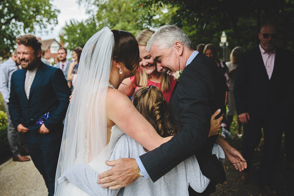 Wedding guests embrace