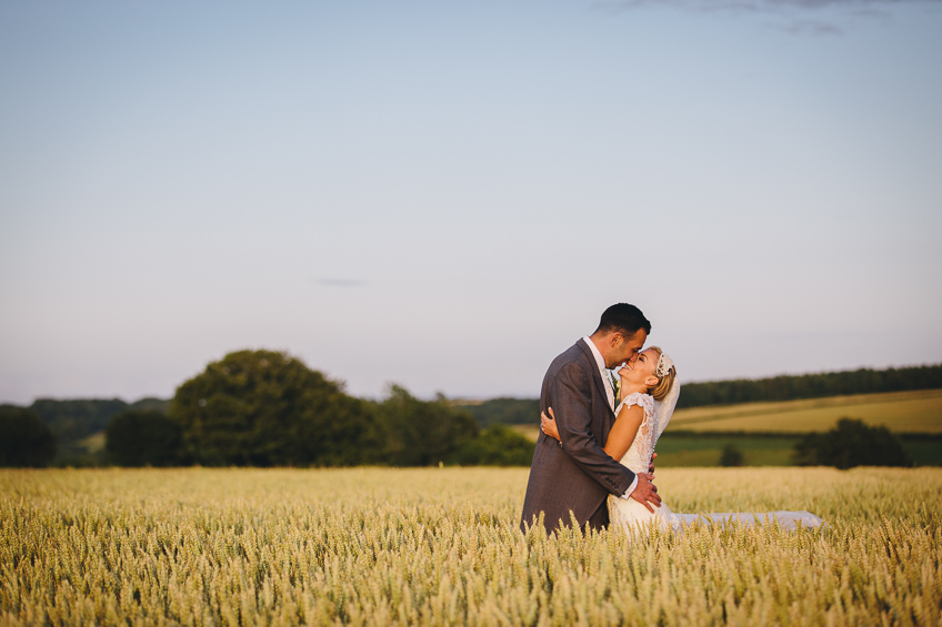 084-kingscote-barn-wedding-photos.jpg