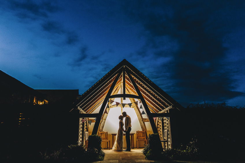 Kingscote barn wedding photography at night