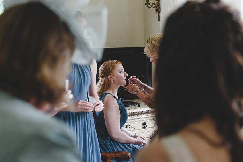 bridesmaid having make-up done