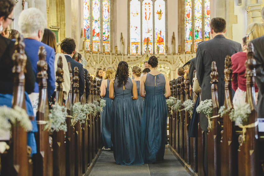 bridesmaids walking up aisle