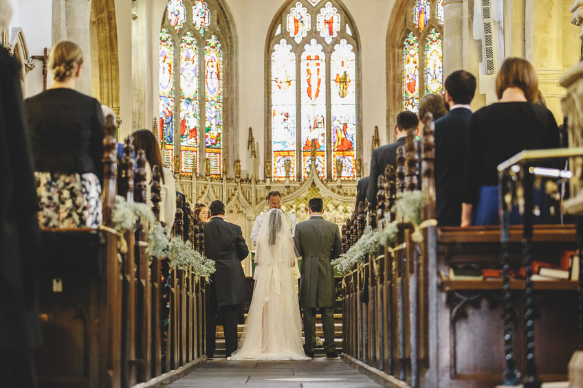 bride and groom during service