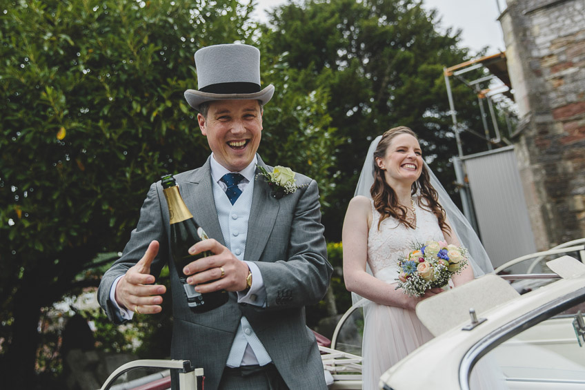 groom celebrating with champagne
