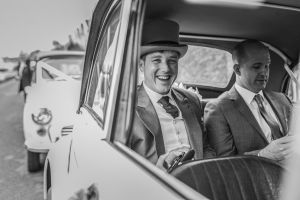 Groom in wedding car