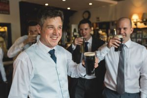 Groom having a pint