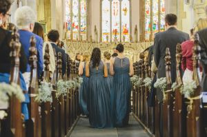 bridesmaids walking up aisle