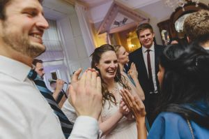 bride laughing on the dancefloor