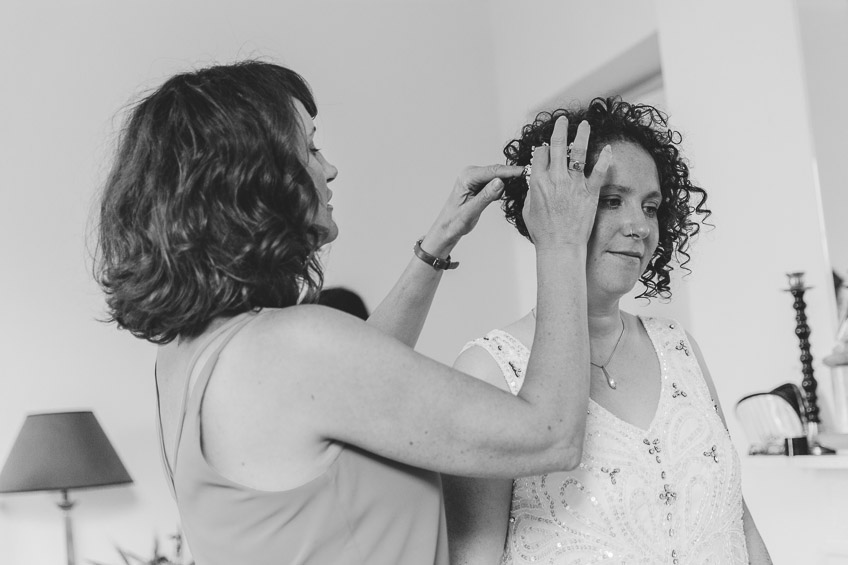 Bride having her hair clip put in place