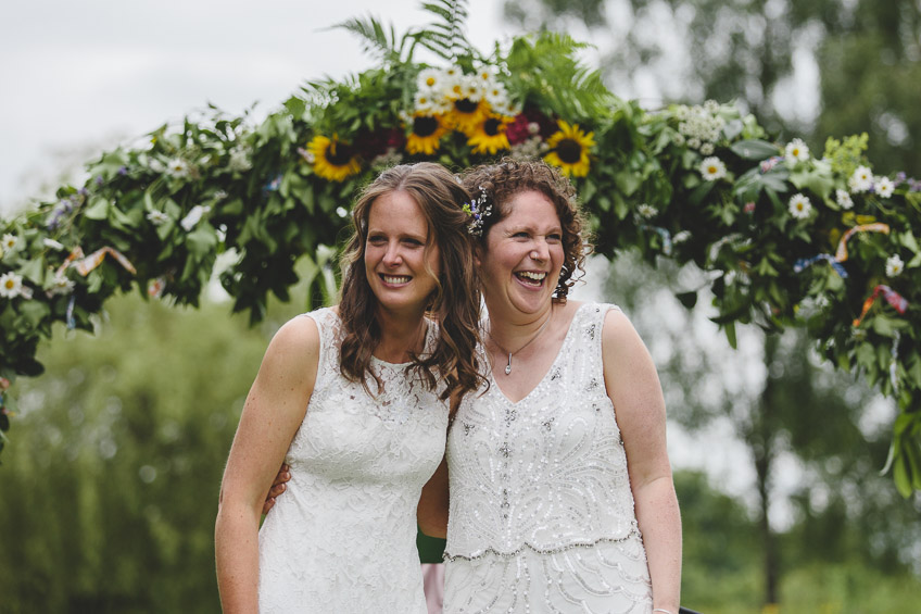 Brides laughing at end of ceremony