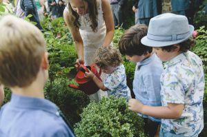 children watering plant